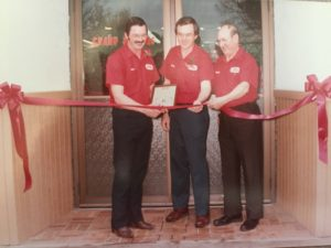 Ribbon cutting during grand opening for the new addition in 1984