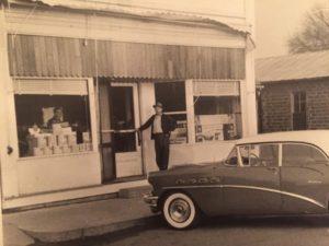 Gerhardt Schmidt in front of his store in 1956